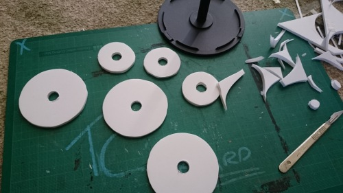 cutting extra padding discs of foamboard