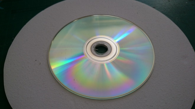 CD stuck to the bottom of the base